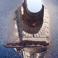 The Parliament Square Campanile reflected on a rain puddle, Trinity College, Dublin, Ireland