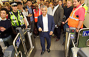 Sadia Khan at London's Night Tube launch at Brixton tube station, London, Great Britain <br /> 19th August 2016 <br /> <br /> The mayor touches his oyster card on the card reader to enter the station to board the first ever night tube <br /> <br /> Sadia Khan, mayor of London,  launched the first night tube service and travelled on a tube train between Brixton and Walthamstow on the Victoria Line. <br />  <br /> He launched the first 24 hour Friday and Saturday night services on the Central and Victoria lines <br /> <br /> Photograph by Elliott Franks <br /> Image licensed to Elliott Franks Photography Services