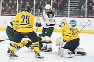 Vermont's Brady Shaw (22) tries to put the puck in the net during the men's hockey game between the Vermont Catamounts and the Quinnipiac Bobcats in the championship game of the Friendship Four hockey tournament at the SSE Arena on Saturday evening November 26, 2016 in Belfast, Ireland. (BRIAN JENKINS/for the FREE PRESS)