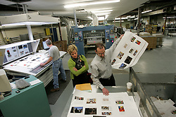 Kelli Patrick and Ken Eberhart spot check printing of Dave LaBelle's book (I don't want to know all the technical stuff I just want to take photos), Friday, Feb. 13, 2009 at Merrick Printing Company in Louisville.