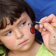 Shealyn Jones, 5 has her face painted by Pam Robbins during the Town of Leland's Founder's Day Saturday September 14, 2013. (Jason A. Frizzelle)