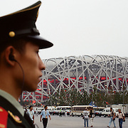 A chinese military member stands on guard outside the Olympic Stadiuml, Beijing, during the summer Olympic Games. August 8 to August 24, 2008. Photo Tim Clayton