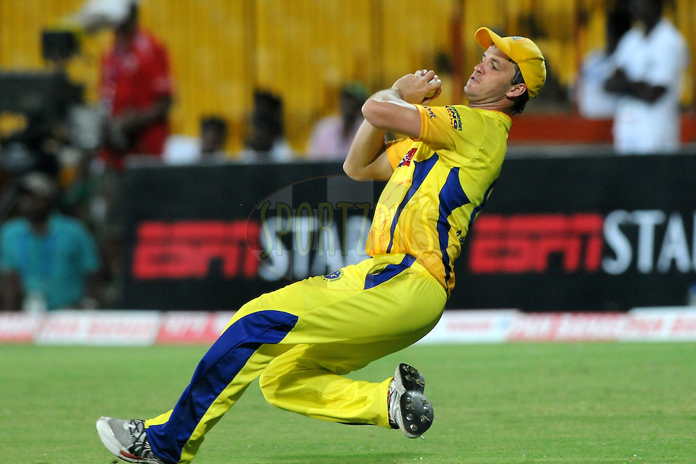 Albie Morkel of Chennai Super Kings finishes a catch during match 3 of the NOKIA Champions League T20 ( CLT20 )between the Chennai Superkings and the Mumbai Indians held at the M. A. Chidambaram Stadium in Chennai , Tamil Nadu, India on the 24th September 2011..Photo by Pal Pillai/BCCI/SPORTZPICS