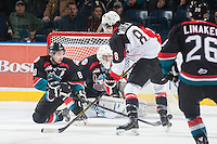 KELOWNA, CANADA - DECEMBER 5: Chase Witala #8 of Prince George Cougars takes a shot as Colten Martin #8 blocks it front of the net of Jackson Whistle #1 of Kelowna Rockets  on December 5, 2014 at Prospera Place in Kelowna, British Columbia, Canada.  (Photo by Marissa Baecker/Shoot the Breeze)  *** Local Caption *** Chase Witala; Colten Martin; Jackson Whistle;