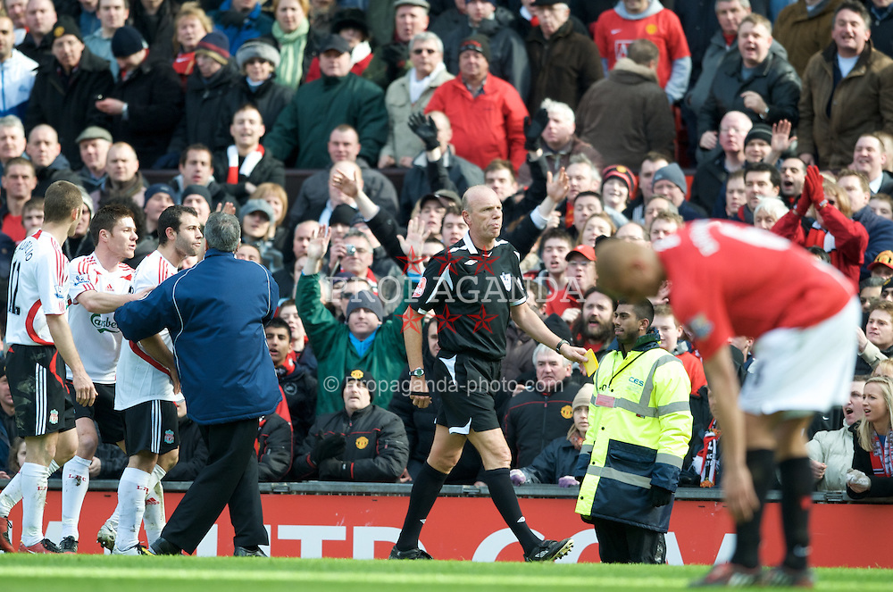 MANCHESTER, ENGLAND - Sunday, March 23, 2008: Liverpool's Javier Mascherano protests his second yellow card by incompetent referee Steve Bennett during the Premiership match against Manchester United at Old Trafford. (Photo by David Rawcliffe/Propaganda)