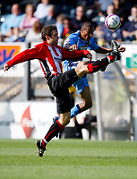 Photo: Richard Lane/Richard Lane Photography. Wycombe Wanderers v Brentford. Coca Cola Fotball League Two. 13/09/2008. Wycombe's Chris Zerbroski and Brentford's Alan Bennett (lt) challenge for the ball.