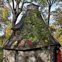 Witch's Hut at Kildonan Park in Winnipeg, Canada<br /> As part of Manitoba's centennial celebration, the local German community donated funds to build the Fairy Tale Cottage in 1970 at Kildonan Park. Better known as the Witch's Hut, its round stone structure is topped by wooden shakes. As you walk through the red door you will see panels portraying the Hänsel and Gretel fairytale by Jacob and Wilhelm Grimm.  It was first published in 1812. Then climb the circular staircase to view a scene of all three characters from this Brothers Grimm classic children's story.  Admission is free.
