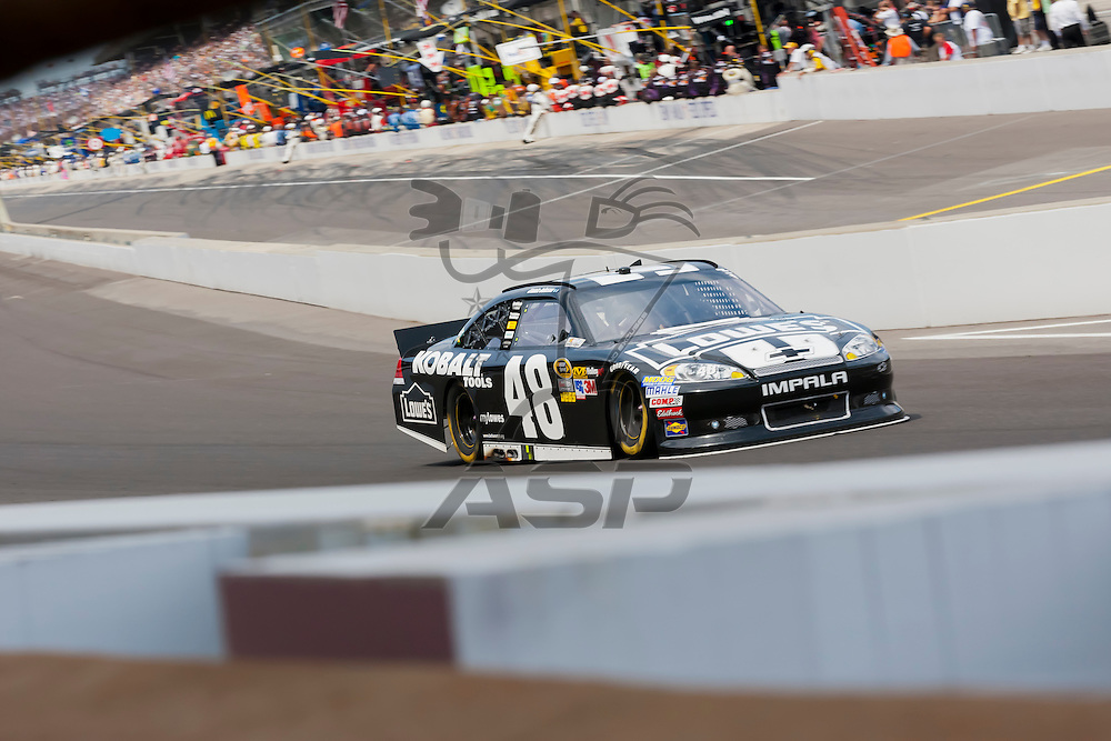 INDIANPOLIS, IN - JUL 29, 2012:  Jimmie Johnson (48) brings his car down the front stretch during the Curtiss Shaver 400 presented by Crown Royal Sprint Cup Series race at the Indianapolis Motor Speedway in Indianapolis, IN.