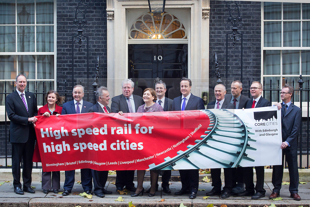 © licensed to London News Pictures. London, UK 21/11/2013. Prime minister David Cameron receives a declaration of support for HS2 by city leaders of the UK's ten largest cities outside of London (Birmingham, Bristol, Leeds, Liverpool, Manchester, Newcastle, Nottingham, Sheffield, Glasgow, Edinburgh) on Downing Street on Thursday, November 21, 2013. Photo credit: Tolga Akmen/LNP