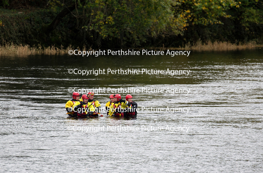Firefighters from the Scottish Fire & Rescue Service and Paramedics from the Scottish Ambulance Service parctice water rescue skills in the River Tay in Perth….31.10.17<br />Picture by Graeme Hart.<br />Copyright Perthshire Picture Agency<br />Tel: 01738 623350  Mobile: 07990 594431