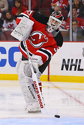 Mar 27, 2014; Newark, NJ, USA; New Jersey Devils goalie Martin Brodeur (30) passes the puck during the second period at Prudential Center.