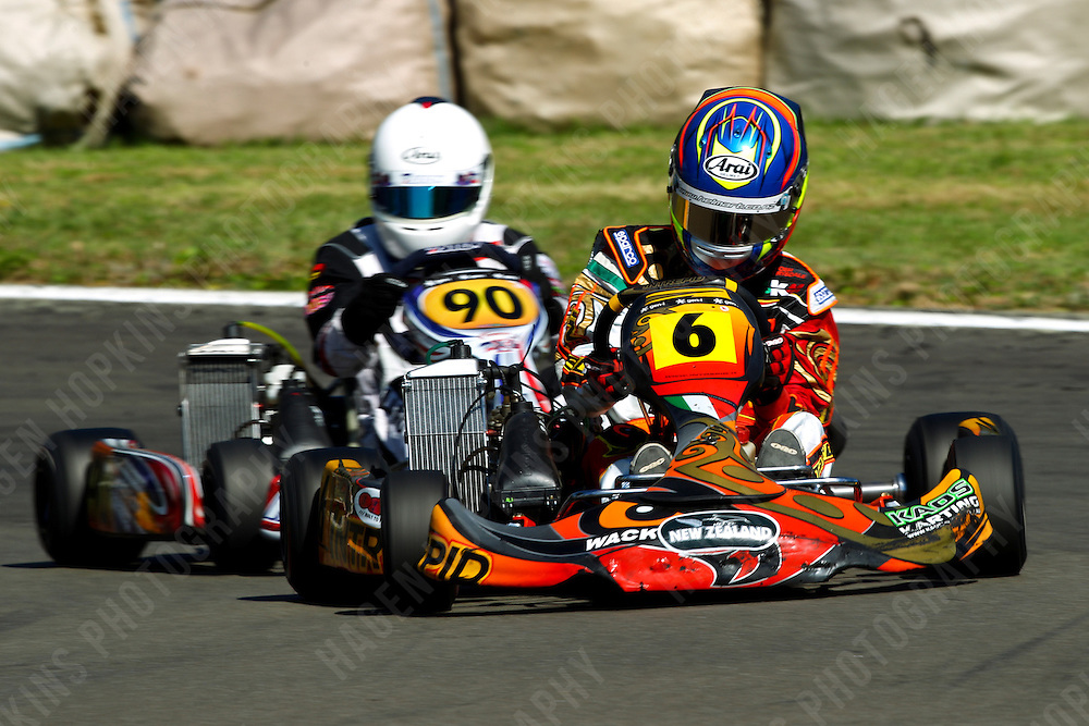 Tim  Jefferies, 6, Scott Manson, 90, 2012 Twilight Trans-Tasman Challenge at Manawatu Kart Club in Palmerston North, New Zealand on Saturday, 18 January 2012. Credit: Hagen Hopkins.