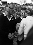 Wilson Whineray delivers his halftime team talk at Eden Park during the first test of the 1961 series between NZ and France. With Whineray is hooker Dennis Young.<br /> Photosport