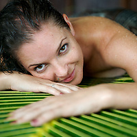 A palm leave forms part of relaxation treatment in a day spa at the Wananvu resort in Fiji