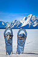 Snowshoe on frozen Jackson Lake.  Grand Teton Range in Grand teton National Park, WY on a sunny day.  Winter scene.