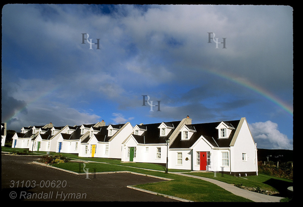 Rainbow arches over condos of Dingle Harbour Lodge on a September afternoon in  Dingle, Ireland.