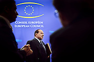 Silvio Berlusconi, Italy's prime minister, speaks to the media as he departs, following an emergency European council summit to solve Europe's debt crisis at the European Council headquarters in Brussels, Belgium, on Thursday, Oct. 27, 2011. (Photo © Jock Fistick)