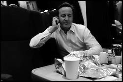 Leader of the Conservative Party David Cameron on the phone to his wife Samantha as he gets  the train back to London after doing his 48th Cameron Direct in Bedford ,Tuesday September 8, 2009. .Photo By Andrew Parsons / i-Images