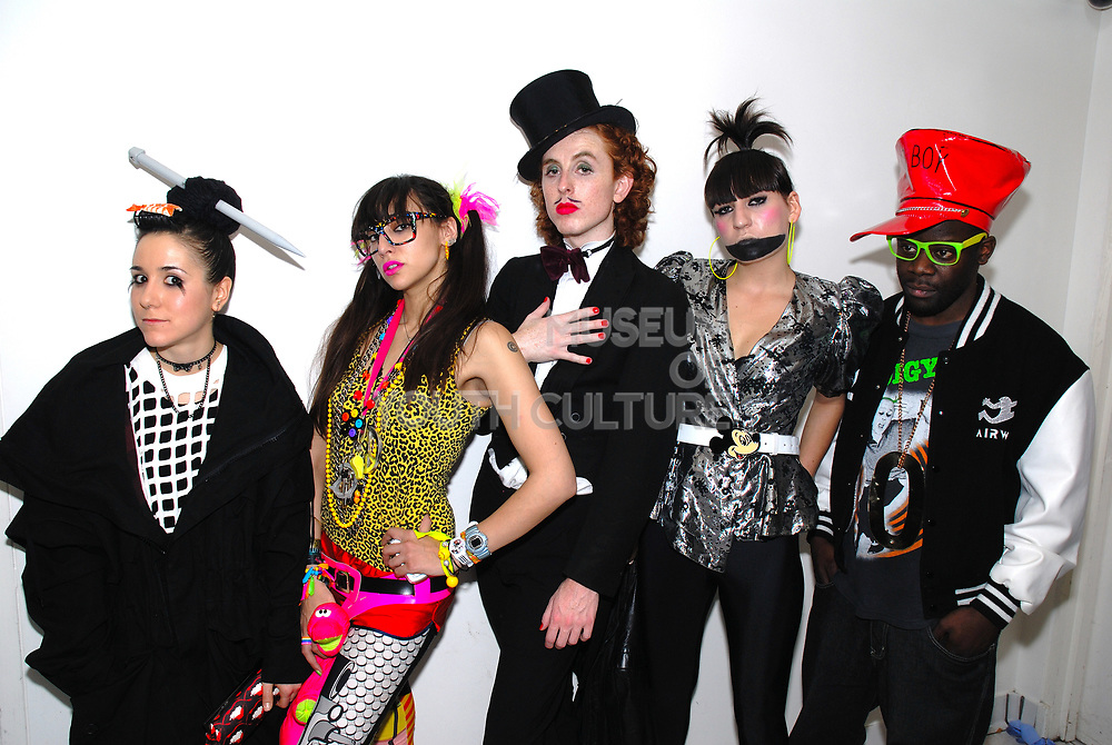 Namalee Bolle (second left) in New Rave styles and a group of club kids posing, Anti-Social, London December 2006