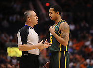 Mar. 14, 2012; Phoenix, AZ, USA;  Utah Jazz guard Devin Harris (5) talks to an NBA Official while playing against the Phoenix Suns during the first half at the US Airways Center.  The Suns defeated the Jazz 120-111. Mandatory Credit: Jennifer Stewart-US PRESSWIRE.