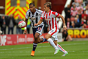 West Bromwich Albion forward Jose Salomon Rondon and Stoke City defender Marc Muniesa during the Barclays Premier League match between Stoke City and West Bromwich Albion at the Britannia Stadium, Stoke-on-Trent, England on 29 August 2015. Photo by Aaron Lupton.