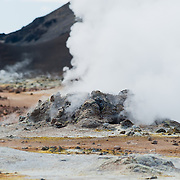 Tourist at the Namaskard geothermal area, Iceland