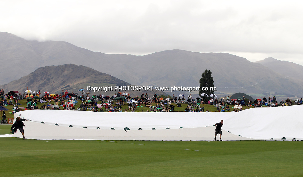 The covers come on the field as the rain falls at the Queenstown Events Centre. 2nd ODI, Black Caps v Pakistan, One Day International Cricket. Queenstown, New Zealand. Wednesday 26  January 2011. Photo: Andrew Cornaga/photosport.co.nz