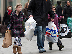 © under licence to London News Pictures 12/12/2010 Christmas shoppers were out in force today (Sunday) as car parks were full and the streets packed with shoppers looking for Christmas presents. Picture shows a family coming out of the Bullring shopping centre in Birmingham, laden with Christmas presents..Picture credit: Dave Warren/London News Pictures...