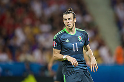 LYON, FRANCE - Wednesday, July 6, 2016: Wales' Gareth Bale in action against Portugal during the UEFA Euro 2016 Championship Semi-Final match at the Stade de Lyon. (Pic by David Rawcliffe/Propaganda)