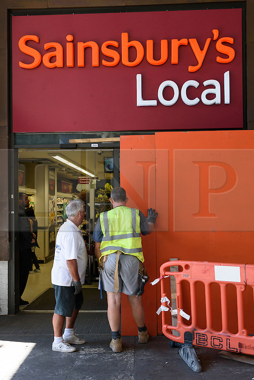 © Licensed to London News Pictures. 26/08/2016.  Sainsburys Local supermarket store is boarded up in Notting Hill ahead of the annual Notting Hill Carnival which starts this bank holiday weekend.  London, UK. Photo credit: Ray Tang/LNP