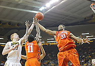 November 29, 2011: Iowa Hawkeyes forward Aaron White (30), Clemson Tigers guard Andre Young (11), and Clemson Tigers forward/center Devin Booker (31) battle for a rebound during the first half of the NCAA basketball game between the Clemson Tigers and the Iowa Hawkeyes at Carver-Hawkeye Arena in Iowa City, Iowa on Tuesday, November 29, 2011. Clemson defeated Iowa 71-55 in the Big Ten-ACC Challenge game.