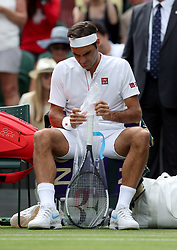 Roger Federer on day three of the Wimbledon Championships at the All England Lawn Tennis and Croquet Club, Wimbledon