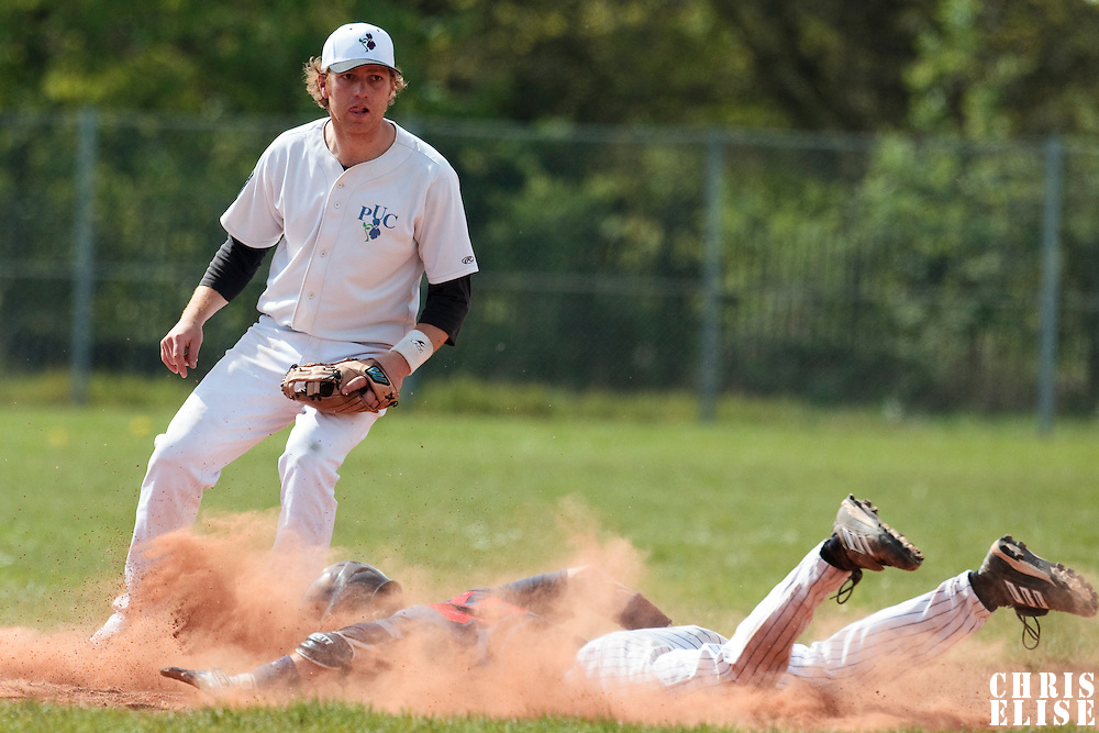 25 April 2010: Nicolas Dubaut watches as Luc Piquet dives safely into second base during game 1/week 3 of the French Elite season won 12-4 by Rouen over the PUC, at the Pershing Stadium in Vincennes, near Paris, France.