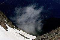 Russia, Caucasus, Teberdinsky biosphere reserve. White cloud over mountain. Near Dombay.