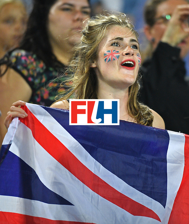 A Britain fan holds a Union Jack flag during the women's quarterfinal field hockey Britain vs Spain match of the Rio 2016 Olympics Games at the Olympic Hockey Centre in Rio de Janeiro on August 15, 2016. / AFP / Carl DE SOUZA        (Photo credit should read CARL DE SOUZA/AFP/Getty Images)