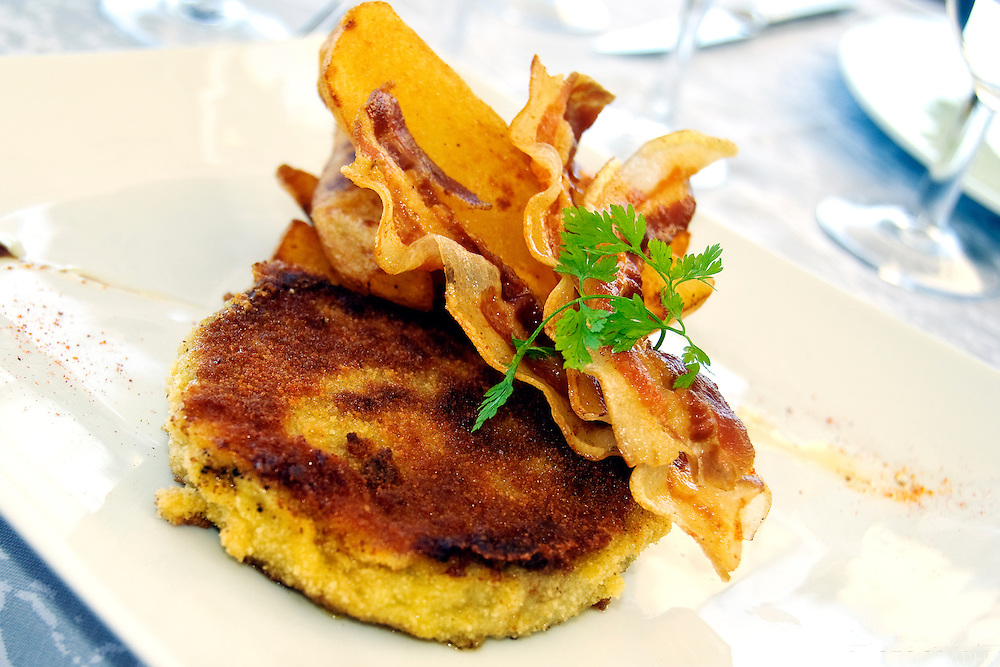 Polenta crusted fish cake with crispy bacon