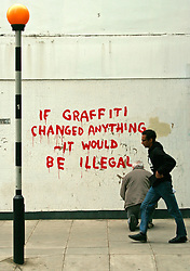 "© London News Pictures. LONDON, UK 26/04/2011. Fitzrovia's Clipstone Street gets a new piece of street art, thought to be by graffiti artist Banksy. This new addition to London comes complete with famous trademark Banksy rat with the wording ""If Graffiti Changed Anything It Would Be Illegal"" in red paint.  The work appeared over the April Bank Holiday weekend 25/04/2011. Credit line should read: Simon Lamrock/London News Pictures."