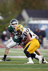 12 November 2011:  Nick Mark wraps up a traveling Benjamin Hodges during an NCAA division 3 football game between the Augustana Vikings and the Illinois Wesleyan Titans in Tucci Stadium on Wilder Field, Bloomington IL