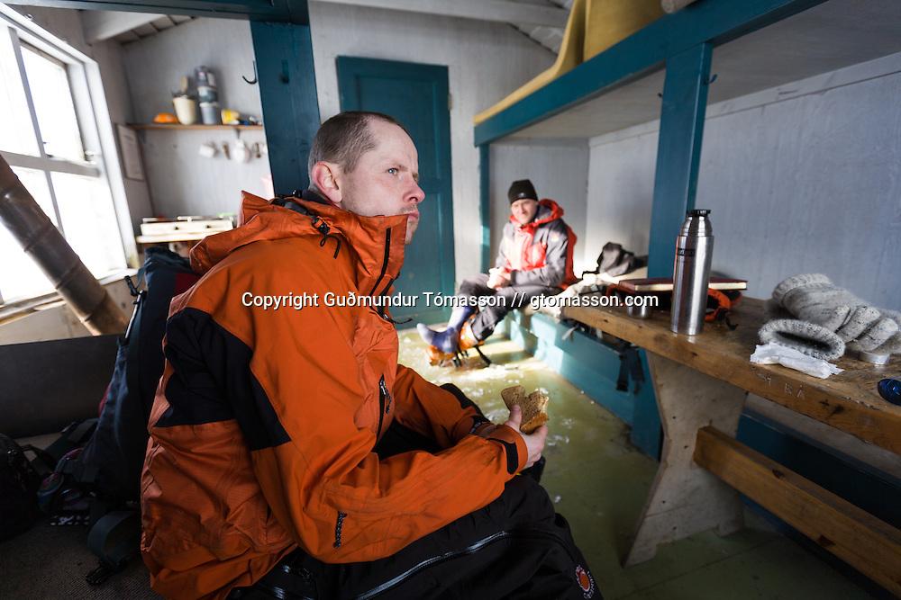 Jón Haukur Steingrímsson and Guðmundur Helgi Christensen inside the Icelandic Alpine club hut at Botnsúlur mountains.