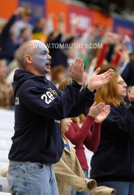 Syracuse, N.Y. - A Falconer High School football fan wearing blue and yellow face paint cheers for his team during the state Class D championship game against Dobbs Ferry at the Carrier Dome on Nov. 25, 2006. ©Tom Bushey