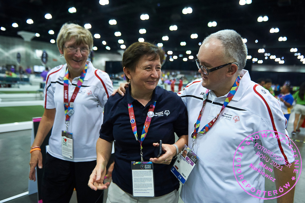 SO Poland athletes (L) Barbala Zapala and (R) Rafal Bednarczyk celebrate victory with their trainer coach at bocce competition during seventh day of the Special Olympics World Games Los Angeles 2015 on July 31, 2015 at South Hall of Convention Centre  in Los Angeles, USA.<br /> <br /> USA, Los Angeles, July 31, 2015<br /> <br /> Picture also available in RAW (NEF) or TIFF format on special request.<br /> <br /> For editorial use only. Any commercial or promotional use requires permission.<br /> <br /> Adam Nurkiewicz declares that he has no rights to the image of people at the photographs of his authorship.<br /> <br /> Mandatory credit:<br /> Photo by © Adam Nurkiewicz / Mediasport