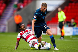 Alfie Kilgour of Bristol Rovers takes on Niall Ennis of Doncaster Rovers - Mandatory by-line: Robbie Stephenson/JMP - 19/10/2019 - FOOTBALL - The Keepmoat Stadium - Doncaster, England - Doncaster Rovers v Bristol Rovers - Sky Bet League One