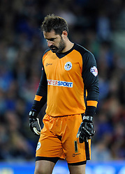 Wigan Athletic's Scott Carson cuts a dejected figure as Wigan lose 1-0 to Cardiff City - Photo mandatory by-line: Dougie Allward/JMP - Mobile: 07966 386802 19/08/2014 - SPORT - FOOTBALL - Cardiff - Cardiff City Stadium - Cardiff City v Wigan Athletic - Sky Bet Championship