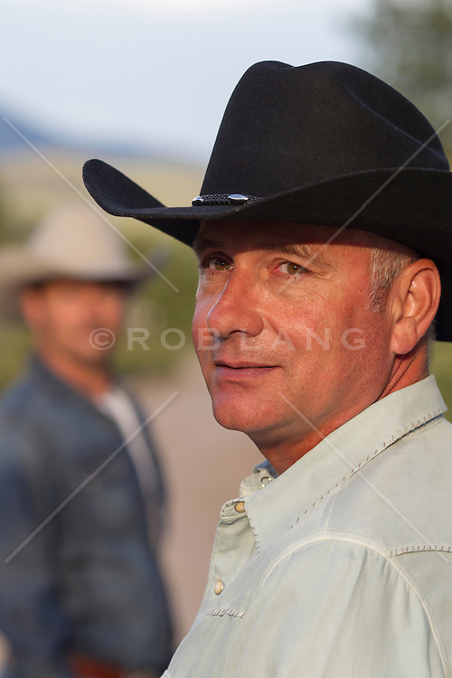 good looking middle aged cowboy outdoors