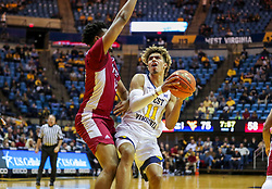 Nov 28, 2018; Morgantown, WV, USA; West Virginia Mountaineers forward Emmitt Matthews Jr. (11) shoots in the lane during the second half against the Rider Broncs at WVU Coliseum. Mandatory Credit: Ben Queen-USA TODAY Sports