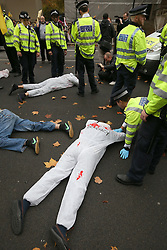 © Licensed to London News Pictures. 05/11/2015. London, UK. Protestors lie down near Downing Street during the visit of Egyptian President Sisi. Photo credit: Peter Macdiarmid/LNP