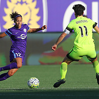 Seattle Reign FC midfielder Keelin Winters (11) challenges Orlando Pride defender Kristen Edmonds (12) during a NWSL soccer match at Camping World Stadium on May 8, 2016 in Orlando, Florida. (Alex Menendez via AP)