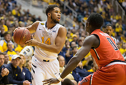 West Virginia Mountaineers guard Gary Browne (14) tries to pass against the Texas Tech Red Raiders during the first half at the WVU Coliseum.
