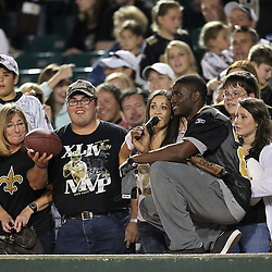 May 17, 2011; Metairie, LA, USA; New Orleans Saints running back Reggie Bush (25) interviews fans during the Heath Evans Foundation charity softball showdown featuring the offense versus the defensive players at Zephyrs Field.  Mandatory Credit: Derick E. Hingle