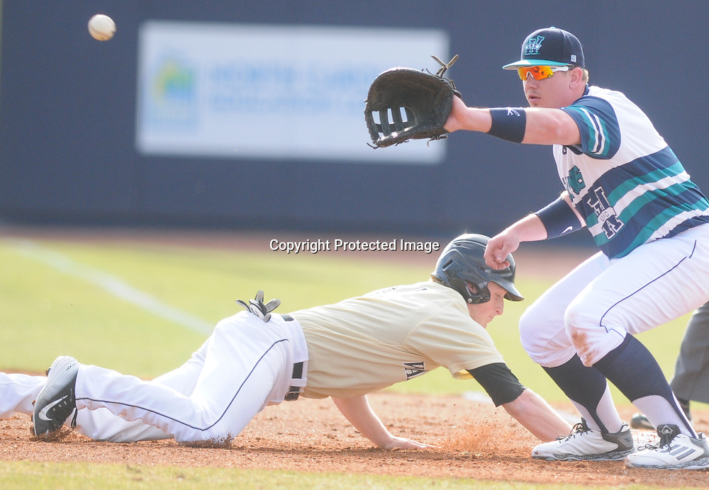 Wake Forest's Jonathan Pryor tags back to first as UNCW's Corey Dick covers the bag Sunday February 22, 2015 during the Hughes Brothers Challenge at Brooks Field. (Jason A. Frizzelle)